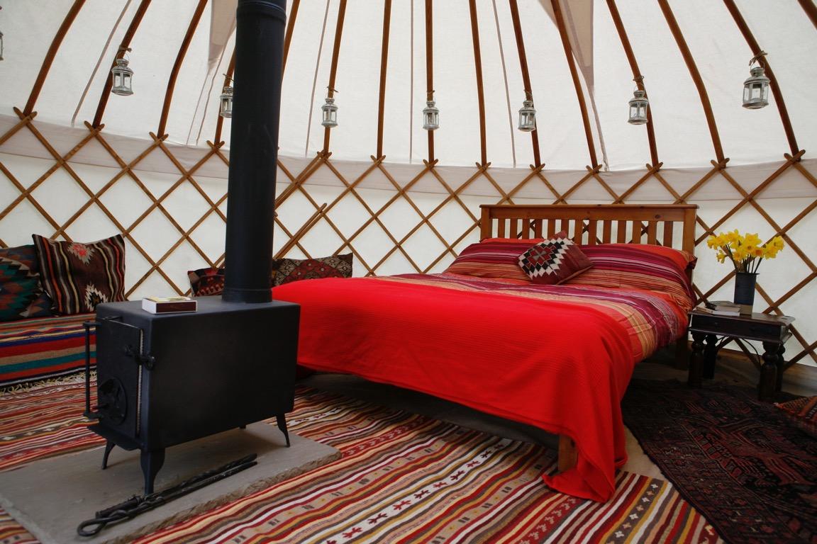 Luxury glamping interior of Roundhouse hire yurt.
