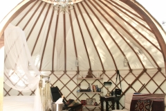 Wedding night yurt with art deco bed from Roundhouse Yurts