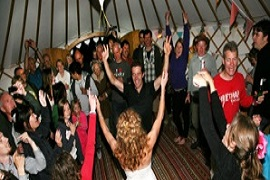 A party inside of a hired Roundhouse Yurt.