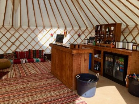 Roundhouse Yurt Hire with a Bar interior package.