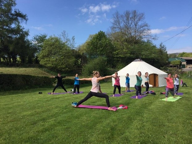 Yoga Yurts in use by a yoga class